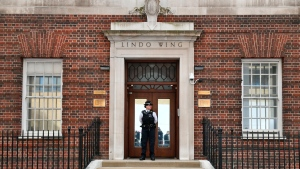A police officers stands outside the Lindo Wing of St Mary's Hospital in Paddington, London, Monday April 23, 2018. (Dominic Lipinski/PA via AP)