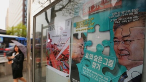 "A South Korean news magazine with front cover photos of South Korea President Moon Jae-in, right, and North Korean leader Kim Jong Un and a headline "" Finding North Korea's hidden picture"" is displayed at the Dong-A Ilbo building in Seoul, South Korea, Monday, April 23, 2018. South Korea halted anti-Pyongyang propaganda broadcasts across the rivals' tense border on Monday as officials from the two Koreas met again to work out details of their leaders' upcoming summit talks expected to focus on the North's nuclear program. (AP Photo/Ahn Young-joon)"