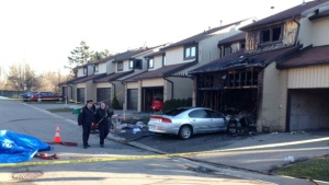 The Office of the Fire Marshal is at the scene of a deadly fire at a Mississauga townhouse. (Cam Woolley/ CP24)
