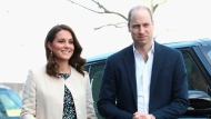 "FILE - In this Thursday, March 22, 2018 file photo, Britain's Prince William and Kate, Duchess of Cambridge visit Sports Aid at the Copperbox Arena in London. Kensington Palace says Prince William's wife, the Duchess of Cambridge has entered a London hospital to give birth to the couple's third child. The former Kate Middleton traveled by car on Monday morning, April 23, 2018 to the private Lindo Wing of St. Mary's Hospital in central London. The palace says she was in ""the early stages of labor."" (Chris Jackson/Pool via AP, File)"
