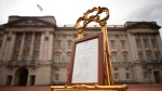 A notice is placed on an easel announcing the birth of the new Royal baby, in the forecourt of Buckingham Palace, in London, Monday, April 23, 2018. Kate, the Duchess of Cambridge gave birth Monday to a healthy baby boy, a third child for Kate and Prince William and fifth in line to the British throne. The palace said the baby prince was born at 11:01 a.m. (1001 GMT; 6:01 a.m. EDT) and weighed in at eight pounds, seven ounces (3.8 kilograms). (Pool Photo via AP)