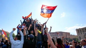 People celebrate Armenian Prime Minister's Serzh Sargsyan's resignation in Republic Square in Yerevan, Armenia, Monday, April 23, 2018. Sargsyan resigned unexpectedly on Monday, an apparent move to bring to an end massive anti-government protests. (Grigor Yepremyan/PAN Photo via AP)