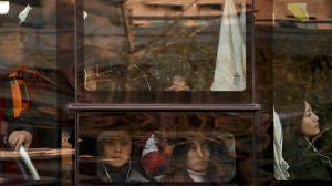 In this Nov. 28, 2017, photo, Chinese women look out of a window of a crowded bus traveling from the outskirts of the capital city during the morning rush hour, in Beijing. Human Rights Watch released the report on Monday, April 23, 2018, gender discrimination is widespread in the Chinese work force, with many hiring advertisements openly calling only for male applicants and using the attractiveness of female co-workers as a draw. (AP Photo/Andy Wong)