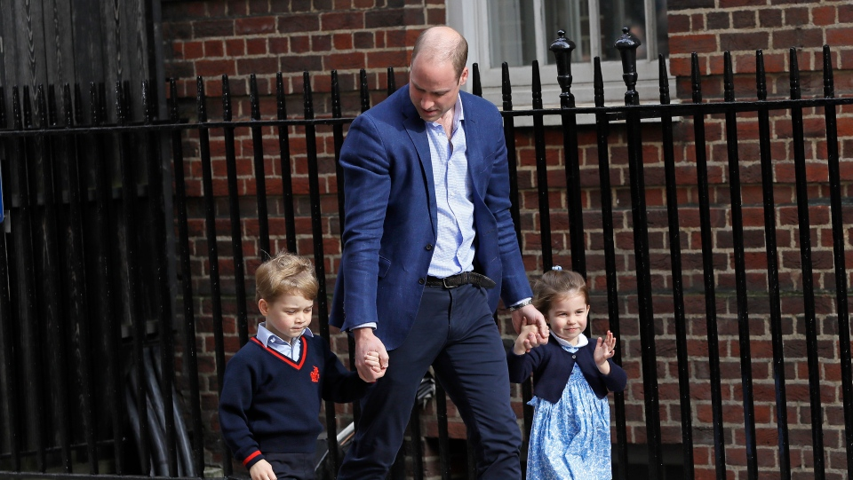 Britain's Prince William arrives with Prince George and Princess Charlotte back to the Lindo wing at St Mary's Hospital in London London, Monday, April 23, 2018. T(AP Photo/Kirsty Wigglesworth)