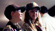 "In a Thursday, March 1, 2018 photo, Ian Weir, left, smiles as he stands with his twin sister Tatum after a cub scout meeting in Madbury, N.H. Fifteen communities in New Hampshire are part of an ""early adopter"" program to allow girls to become Cub Scouts and eventually Boy Scouts. The twins already are planning to become the first set of girl-boy siblings to become Eagle Scouts. (AP Photo/Charles Krupa)"
