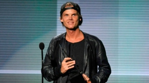 In this Nov. 24, 2013 file photo, Avicii accepts the award for favorite artist - electronic dance music at the American Music Awards in Los Angeles. (Photo by John Shearer/Invision/AP, File)