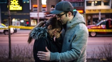 Farzad Salehi consoles his wife Mehrsa Marjani who was is a nearby cafe and witnessed the aftermath when a van hit a number of pedestrians on Yonge Street and Finch in Toronto on Monday, April 23, 2018. Ten people died and 15 others were injured when a van mounted a sidewalk and struck multiple pedestrians along a stretch of one of Toronto's busiest streets. THE CANADIAN PRESS/Aaron Vincent Elkaim