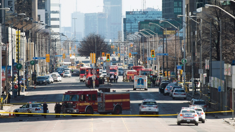 First responders close down Yonge Street in Toronto after a van mounted a sidewalk crashing into a number of pedestrians on Monday, April 23, 2018. THE CANADIAN PRESS/Nathan Denette