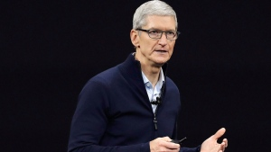 In this Sept. 12, 2017, file photo, Apple CEO Tim Cook, shows new Apple Watch Series 3 product at the Steve Jobs Theater on the new Apple campus in Cupertino, Calif. (AP Photo/Marcio Jose Sanchez, File)