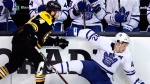 Toronto Maple Leafs center Tyler Bozak, right, hits the ice on a check by Boston Bruins left wing Jake DeBrusk, left, during the second period of Game 7 of an NHL hockey first-round playoff series in Boston, Wednesday, April 25, 2018. (AP Photo/Charles Krupa)