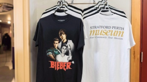 Fan shirts for Justin Bieber are for sale at the Stratford Perth Museum for the Steps to Stardom exhibition about Justin Bieber in Stratford Ont. on Saturday, Feb.17, 2018. Justin Bieber has made an unexpected visit to an exhibit on himself in his hometown of Stratford, Ont. THE CANADIAN PRESS/Hannah Yoon