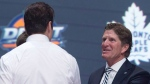 Toronto Maple Leafs first overall pick Auston Matthews shakes hands with Maple Leafs head coach Mike Babcock at the NHL draft in Buffalo, N.Y. on Friday June 24, 2016. THE CANADIAN PRESS/Nathan Denette