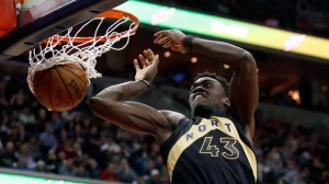 Toronto Raptors forward Pascal Siakam dunks during the first half of Game 6 of the team's NBA basketball first-round playoff series against the Washington Wizards, Friday, April 27, 2018, in Washington. (AP Photo/Alex Brandon)