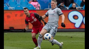 Toronto FC's Sebastian Giovinco (left) moves the ball past Chicago Fire's Bastian Schweinsteiger during first half MLS soccer action in Toronto on Saturday, April 28, 2018. THE CANADIAN PRESS/Chris Young