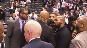 Drake exchanges words with Cleveland Cavaliers Kendrick Perkins after the Raptors loss to the Cavs in Toronto on May 1, 2018. (Twitter/@mcten)