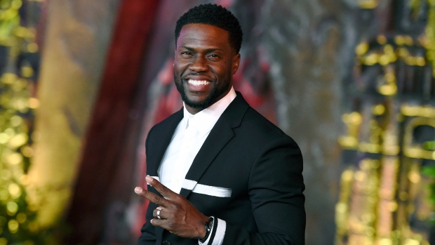 In this Dec. 11, 2017 file photo, Kevin Hart arrives at the Los Angeles  premiere of
