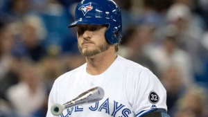 Toronto Blue Jays' Josh Donaldson tosses his bat after striking out in the ninth inning of their American League MLB baseball game against the New York Yankees, in Toronto on Friday, March 30, 2018. THE CANADIAN PRESS/Fred Thornhill
