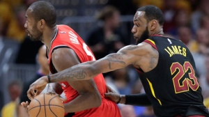 Cleveland Cavaliers' LeBron James (23) strips the ball from Toronto Raptors' Serge Ibaka in the first half of Game 4 of an NBA basketball second-round playoff series, Monday, May 7, 2018, in Cleveland. (AP Photo/Tony Dejak)