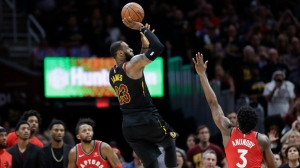 Cleveland Cavaliers' LeBron James (23) hits the game-winning shot as Toronto Raptors' OG Anunoby (3) and CJ Miles (0) watch during the second half of Game 3 of an NBA basketball second-round playoff series, Saturday, May 5, 2018, in Cleveland. (AP Photo/Tony Dejak)