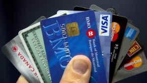 Credit cards are displayed in Montreal, Wednesday, December 12, 2012. European financial technology company TransferWise is planning a Canadian launch next year for its borderless debit Mastercard, which allows users to hold balances in multiple currencies and spend it at home and abroad with lower foreign exchange fees than traditional banks. CANADIAN PRESS/Ryan Remiorz