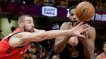Cleveland Cavaliers' Tristan Thompson, right, and Toronto Raptors' Jonas Valanciunas, from Lithuania, battle for the ball in the first half of Game 4 of an NBA basketball second-round playoff series, Monday, May 7, 2018, in Cleveland. (AP Photo/Tony Dejak)