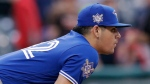 Toronto Blue Jays relief pitcher Roberto Osuna watches the final out in the 11th inning in the first game of a baseball doubleheader against the Cleveland Indians, Thursday, May 3, 2018, in Cleveland. The Blue Jays won 13-11. (AP Photo/Tony Dejak)