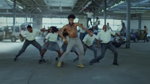 "Donald Glover aka ""Childish Gambino"" performs in the music video for 'This is America' in a screen capture image."