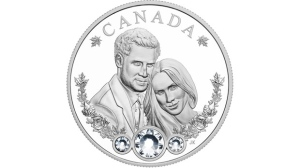 A commemorative coin to mark the Royal Wedding of Prince Harry and Ms. Meghan Markle is shown in this undated rendering. A commemorative coin for Prince Harry and Meghan Markle's wedding will be adorned with crystals and Canadian maple leaves. The Royal Canadian Mint has revealed a 99.99 per cent pure silver keepsake to celebrate the May 19 nuptials at Windsor Castle. THE CANADIAN PRESS/HO - Royal Canadian Mint