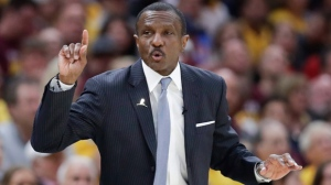 Toronto Raptors head coach Dwane Casey gestures against the Cleveland Cavaliers in the first half of Game 4 of an NBA basketball second-round playoff series, Monday, May 7, 2018, in Cleveland. (AP Photo/Tony Dejak)