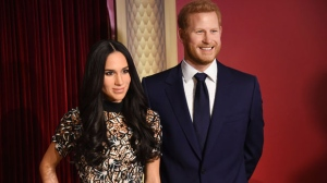 Wax figures depicting Meghan Markle, left, and Britain's Prince Harry appear at an unveiling of the Royal Palace Experience exhibit at Madame Tussauds New York on Wednesday, May 9, 2018, in New York. The couple will wed on May 19. (Photo by Evan Agostini/Invision/AP)