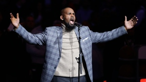 In this Nov. 17, 2015, file photo, musical artist R. Kelly performs the national anthem before an NBA basketball game between the Brooklyn Nets and the Atlanta Hawks in New York. (AP Photo/Frank Franklin II, File)