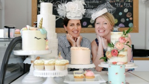 Le Dolci bakery owner Lisa Sanguedolce, left, and general manager Danielle Ellis, are promoting a selection of royal-inspired desserts in Toronto, ahead of Prince Harry's wedding to Meghan Markle, Tuesday, May 8, 2018. THE CANADIAN PRESS/Galit Rodan