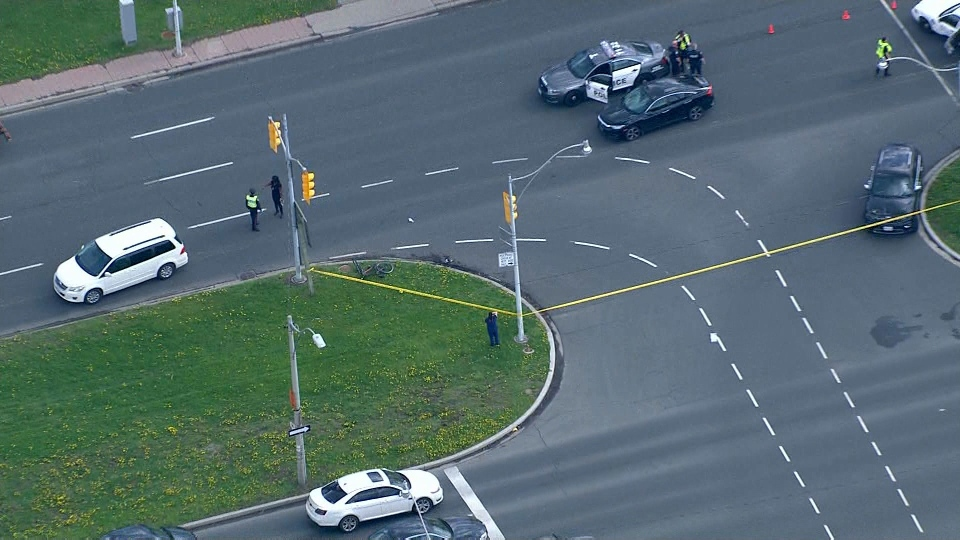 Police respond to the scene of a collision involving a cyclist at Colbourne Lodge Drive and Lake Shore Boulevard Tuesday May 15, 2018.