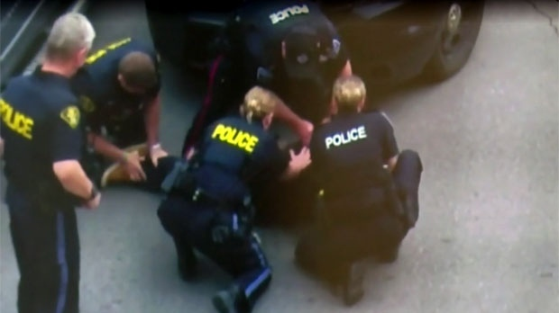 A suspect is seen being put under arrest by Ontario Provincial Police.