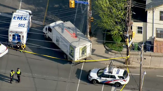 Toronto police's traffic services unit are investigating after a cyclist was struck by a truck in Leslieville on May 16, 2018.