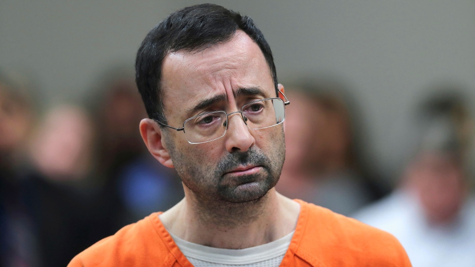 In this Nov. 22, 2017, file photo, Dr. Larry Nassar appears in court for a plea hearing in Lansing, Mich.  (AP Photo/Paul Sancya, File)