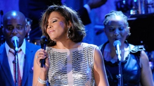 In this Feb. 13, 2011, file photo, singer Whitney Houston performs at the pre-Grammy gala & salute to industry icons with Clive Davis honoring David Geffen in Beverly Hills, Calif. Friends of Whitney Houston allege the singer was molested as a child by her cousin Dee Dee Warwick in a documentary that premiered Thursday May 17, 2018, at the Cannes Film Festival. (AP Photo/Mark J. Terrill, File)