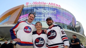 Winnipeg Jets fans, Jeff Peterson, Murray Workman and Buzz Pedersen all from Kenora, Ontario cheer for their teamoutside T-Mobile Arena before the Jets face the Vegas Golden Knights' during Western Conference Finals in Las Vegas, Wednesday, May 16, 2018. THE CANADIAN PRESS/Trevor Hagan