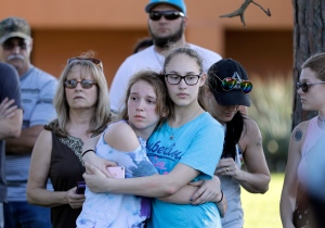 Mourners wait for the start of a prayer vigil following a deadly shooting at Santa Fe High School in Santa Fe, Texas, on Friday, May 18, 2018. (AP Photo/David J. Phillip)