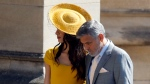 George Clooney and his wife Amal Clooney arrive for the wedding ceremony of Prince Harry and Meghan Markle at St. George's Chapel in Windsor Castle in Windsor, near London, England, Saturday, May 19, 2018. (Odd Anderson/pool photo via AP)