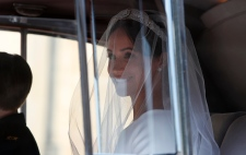 Meghan Markle arrives for the wedding ceremony to Prince Harry at St. George's Chapel in Windsor Castle in Windsor, near London, England, Saturday, May 19, 2018. (AP Photo/Alastair Grant, pool)