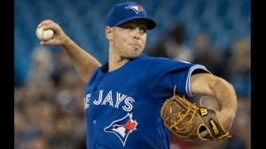 Toronto Blue Jays starting pitcher Sam Gaviglio throws against the Oakland Athletics in the first inning of their American League MLB baseball game in Toronto on Saturday May 19, 2018. THE CANADIAN PRESS/Fred Thornhill