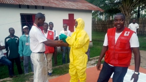 In this photo taken Monday, May 14, 2018, members of a Red Cross team don protective clothing before heading out to look for suspected victims of Ebola, in Mbandaka, Congo. Congo's Ebola outbreak has spread to Mbandaka, a crossroads city of more than 1 million people, in a troubling turn that marks one of the few times the vast, impoverished country has encountered the lethal virus in an urban area. (Karsten Voigt/International Federation of Red Cross and Red Crescent Societies via AP)