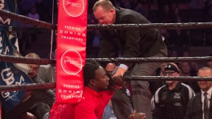 An Ontario boxing commission official tries to remove a fan from the ring during a fight on the undercard of the Adonis Stevenson-Badou Jack boxing card at the Air Canada Centre in Toronto on Saturday, May 19, 2018. A spokesman for the promoter said the spectator had over-imbibed and, thinking the bout was boring, wanted to liven it up by getting into the ring. THE CANADIAN PRESS/Frank Gunn