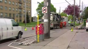 Several homes were evacuated after a car struck a gas main in North York.