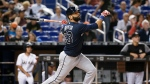 FILE - In this May 10, 2018, file photo, Atlanta Braves' Jose Bautista bats during the fourth inning of a baseball game against the Miami Marlins in Miami. The Braves have released Bautista a month after picking up the veteran slugger and will make Johan Camargo their starting third baseman. (AP Photo/Wilfredo Lee, File)