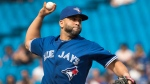 Toronto Blue Jays designated hitter Kendrys Morales pitches during ninth inning American League MLB baseball action against the Oakland Athletics, in Toronto on Sunday, May 20, 2018. THE CANADIAN PRESS/Fred Thornhill