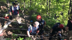 Toronto firefighters conduct a high-angle rescue to remove a man from Etobicoke Creek. (Toronto Fire Service/ Twitter)