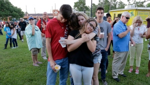 Mourners embrace each other during a prayer vigil following a shooting at Santa Fe High School in Santa Fe, Texas, on Friday, May 18, 2018. (AP Photo/David J. Phillip)