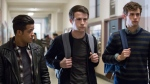 "This image released by Netflix shows, from left, Christian Navarro, Dylan Minnette and Brandon Flynn in ""13 Reasons Why."" (Beth Dubber/Netflix via AP)"